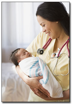 Nurse holds sleeping newborn.