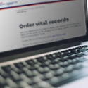 A laptop on the page to order vital records online.